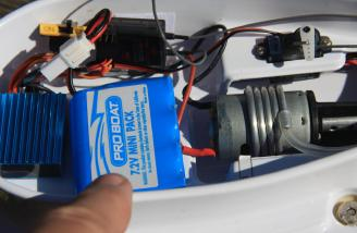 The charged battery pack installed in the hull and secured with Velcro