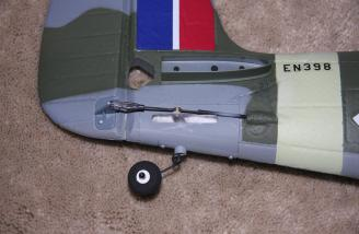 One control rod controls the tail wheel and the rudder as shown in this picture. I recommend you confirm they are aligned before adding the horizontal stabilizer to the fuselage.