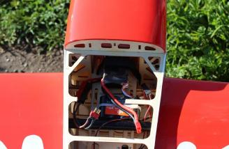 The Genesis Power 4-cell 3300mAh battery pack in the front of the E-flite Extra 300
