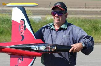 The author, Dick Andersen, holding his E-flite Habu while fighting the wind.