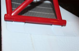 Installing the Cabane struts into the L bracket on the underside of the top wing.