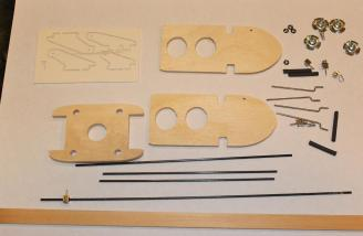 The motor mount, hardware and carbon fiber rods, assorted wood and metal parts