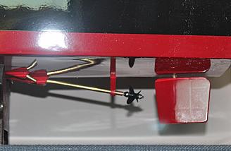 Prop, rudder and a water intake shown at the rear of the hull.