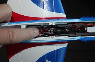Here I am pointing to the bar where the magnet is mounted underneath to secure the power core to the frame.
