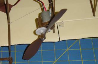 This picture shows the paper shim next to the motor, the nick in the propeller and the slight damage from prop strikes to the wing (left bottom edge).