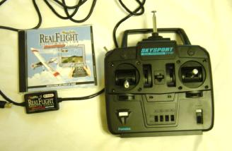 Mini-version of RealFlight simulator with adapter to connect the included transmitter to your computer.