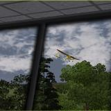 Here we see the FlyZone SkyFly on a close fly-by of the Flight School tower. To get to this screen select View and go to camera position X, select Tower view.