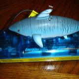 The shark rests on the charger to charge and it takes 10-12 minutes with fresh batteries.