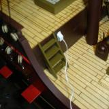 A large hole was drilled so the electrical plug of the carriage light could fit into the hull.