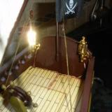 Two high quality carriage lights from the doll house mounted on the stern of the ship. Both lights were off. That is just the flash on the brass of the light on the left.