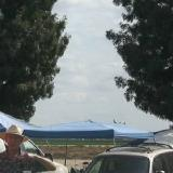 Plane just above the tarp, way right of landing area with no altitude or energy.