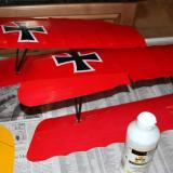 The top sides of both wings got two coats of the matte varnish.