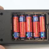 The five supplied AA batteries installed in the charger.
