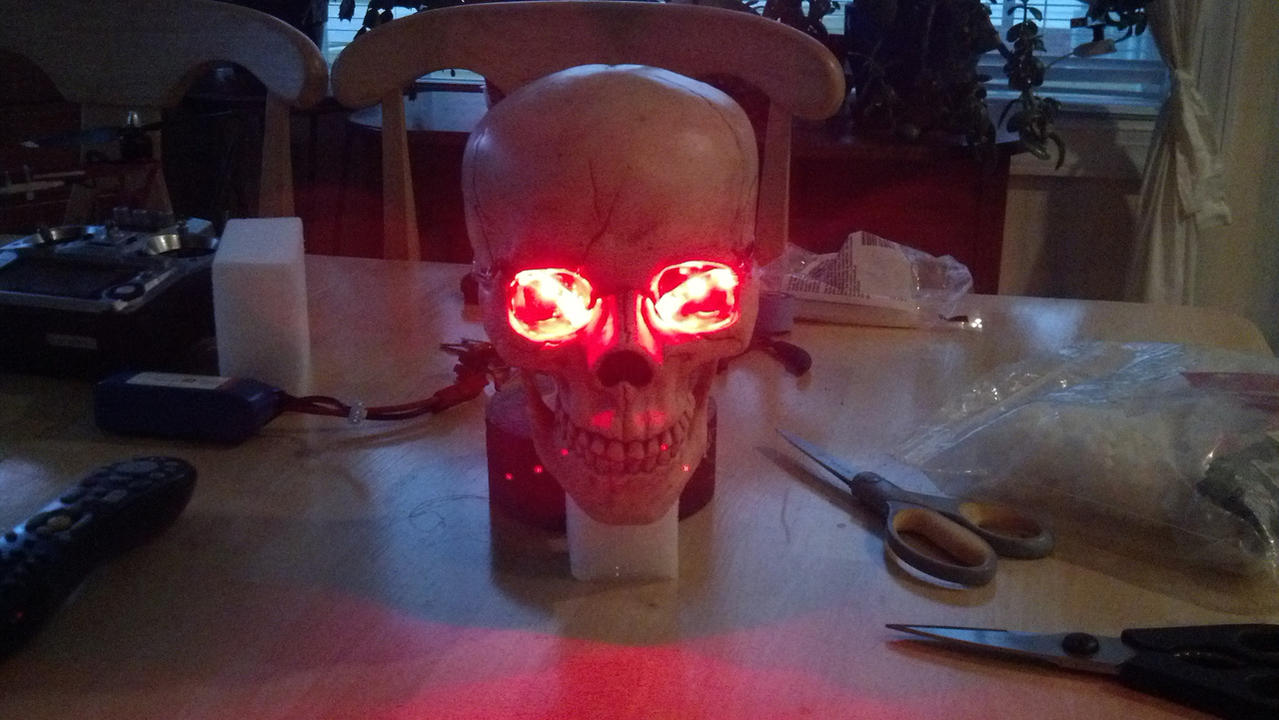 "The red LEDs for the eyes.  I had to do three LEDs as these strips do not allow for single LEDs.  So I aligned them in a sort of ""frown""."