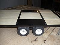 Name: black gooseneck trailer deck (wooden and powder coated).jpg