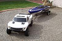 Name: boat trailer being towed.jpg
