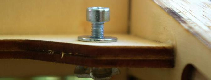 Draw the wing retention blind nuts up in to the ply plate by torquing the fasteners down tightly.