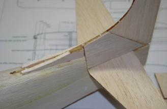 All of the tail pieces are solid balsa. It is better to round the leading edges before you glue them to the fuselage.