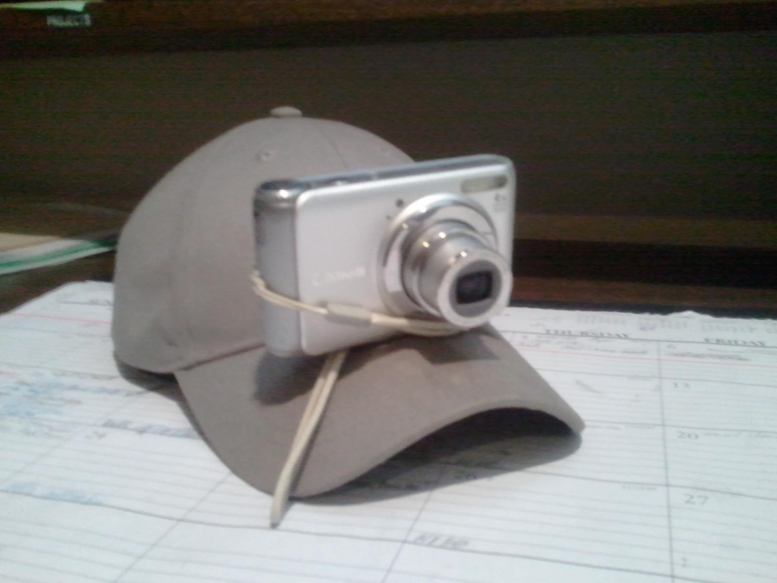 Canon Sureshot Above Simpson Strong Tie Baseball Cap