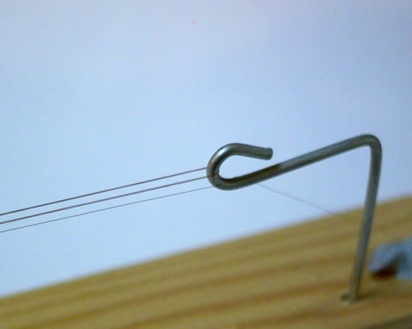 Here you can see the 0.065mm enamelled copper wire I used wrapped 7 times around the hooks.  This method of making wire is good because you can customise the wire totally for different applications.