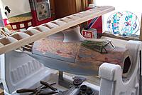 Name: I built a rather skookum balsa saddle for the wing, here I am doing a trial run on fitting plast.jpg