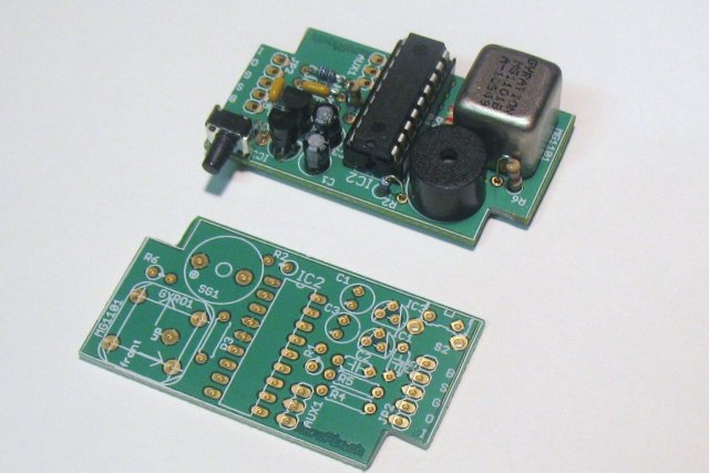 Assembled TrackR1 along side an unpopulated board