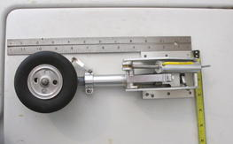 Giant scale 90 degree landing gear with retractable tail wheel