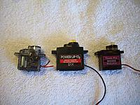 Name: Dynam SBach stock AIL vs PowerUp AS315MG vs TowerPro MG90S 1 servo.jpg Views: 9 Size: 733.7 KB Description: New servo in middle, old servo on left, contender on right that didn't make it.