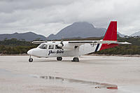 Name: Britten-Norman_BN-2_Islander_with_Mount_Rugby_behind_-_Melaleuca.jpg