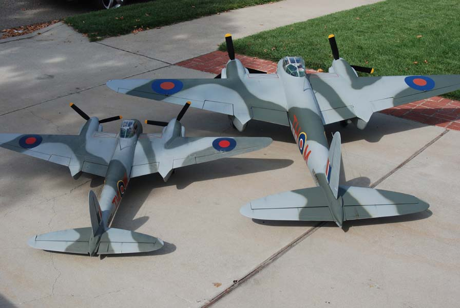 "My 1/8 scale and 1/5 scale Mosquitos, both blown up from a 71"" Brian Taylor design.  I've been flying the 1/8 scale version for over 20 years."
