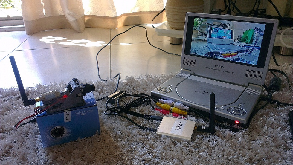 "The camera and transmitter/receiver combo in action on a portable DVD player. Note the depron ""backpack"" prototype"