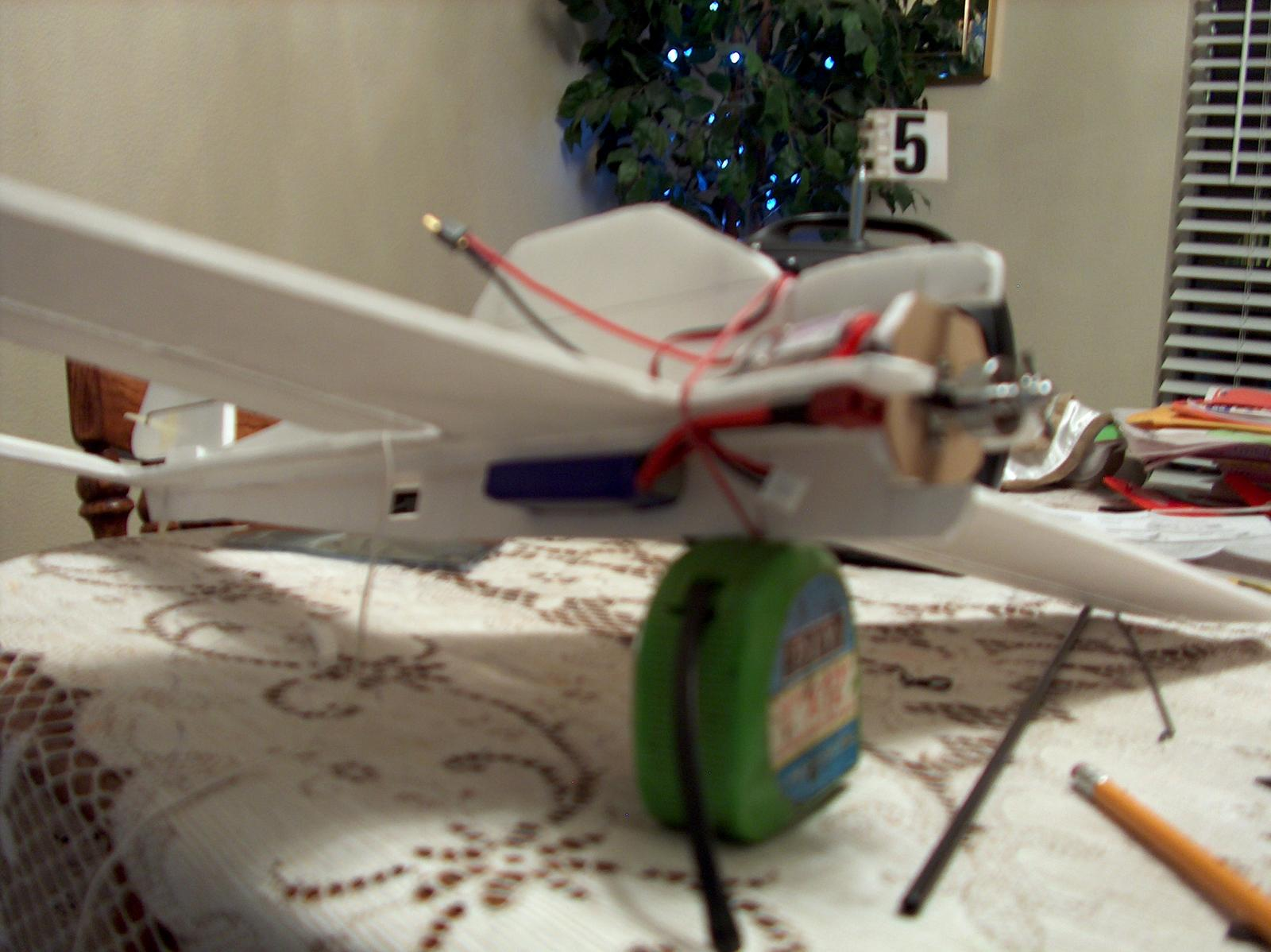 I located the battery underneath the wing for low center of gravity..cut out the foam and slid it in..