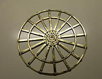 Name: DSC_0015.jpg Views: 58 Size: 201.5 KB Description: Soldering complete. There are 5 hoops on each wheel, 2 water jet cut hubs, and 16 spokes