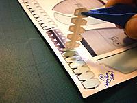 Name: PB241256.jpg Views: 112 Size: 117.3 KB Description: peeling off the edge sticker - carefully
