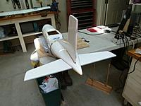 Name: P1010584.jpg Views: 31 Size: 74.2 KB Description: I used a laser to align the control surfaces with respect to each other, here I am gluing and aligning the vertical stabilizer.