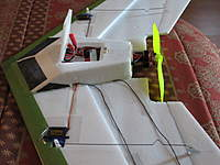 Name: oswv2 022.jpg Views: 1829 Size: 101.6 KB Description: Version2 showing shortened fuse per the plans.  The acess panel was cut out after gluing fuse to wing. Use the center aft panels to line up the fuse when gluing it to wing.  You can also see the wires running to servos imbedded in wing, and the servo cuto