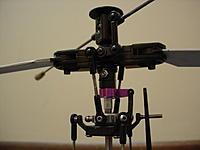 Name: DSC03325.JPG Views: 4 Size: 493.7 KB Description: FX052 head on a Blade 300x using an aluminum shim