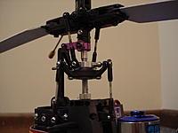 Name: DSC03303.JPG Views: 3 Size: 461.3 KB Description: FX052 head on a Blade 300x using an aluminum shim