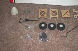 Provided hardware is very complete: wheels, pre-bent gear, spinner, wheel collars, motor mount and clevises.