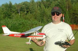 The Cessna 172 and I after a successful maiden.