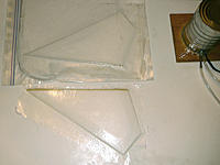Name: vacuum bagging 2nd stabilizer.jpg Views: 171 Size: 184.1 KB Description: Vacuum bagging second stabilizer (top).  The first one is out of the bag (bottom).