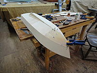 Name: DSC00950.jpg Views: 45 Size: 539.5 KB Description: Added some balsa blocks to the forward frames to give more bearing to the forefoot area. Torquing the original bottom sheeting to the stem put too much stress on the join, so two layers of balsa were utilized.
