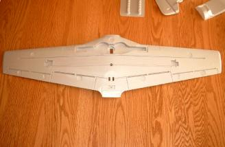 The bottom of the wing has cutouts for the fiberglass wing stiffener, aileron servos, retracts, and flap torque rods.  The ailerons and flaps are also easy to separate from the wing.