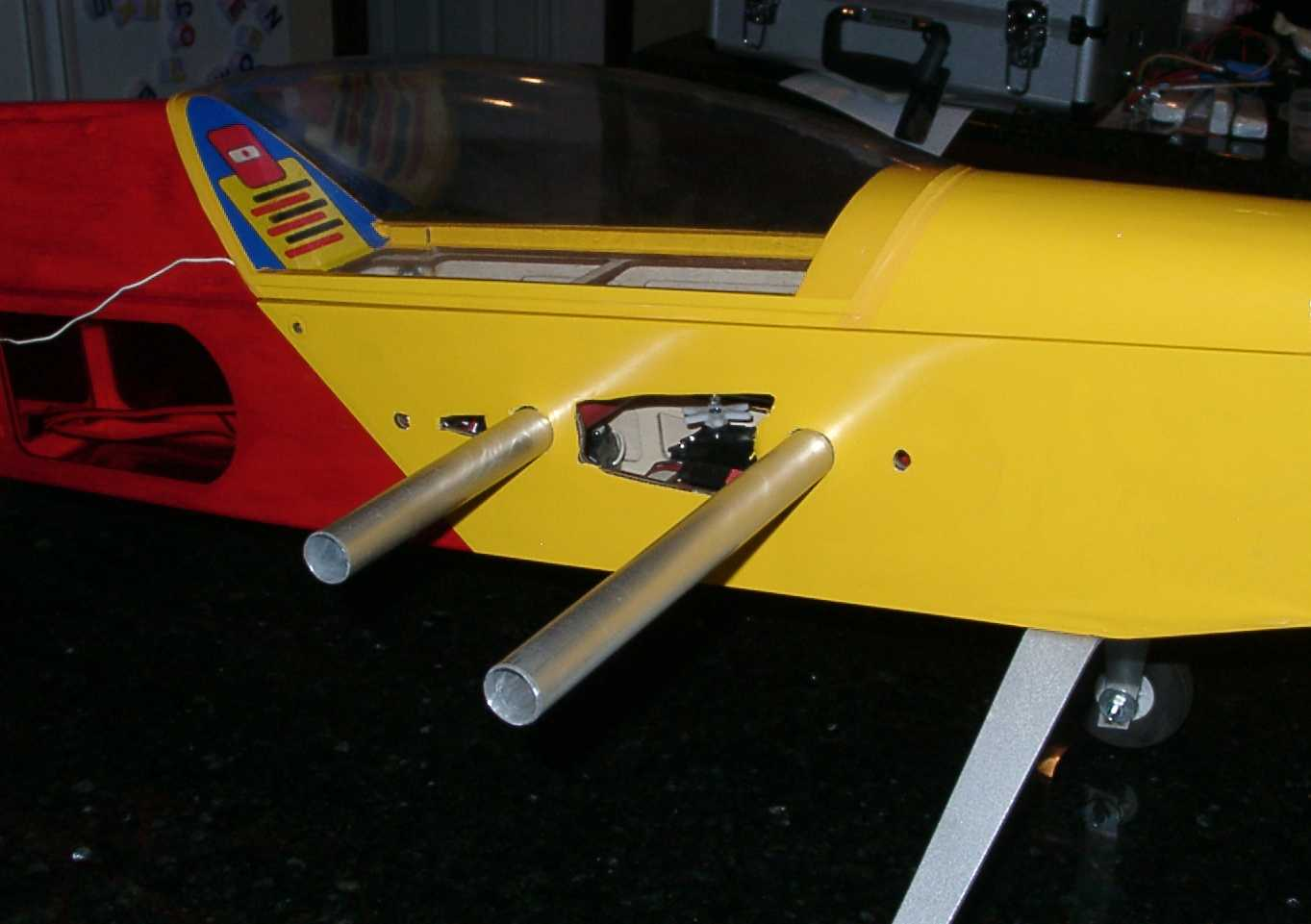 The wings slide on to two aluminum spars that pass through the fuselage. Two nylon bolts secure each wing panel to the fuselage.