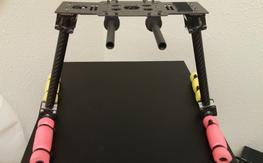 Carbon fiber landing gear with aluminum brackets