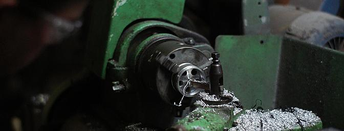 Byron's lathe with one of the 5-hole billet aluminum wheels being fabricated.