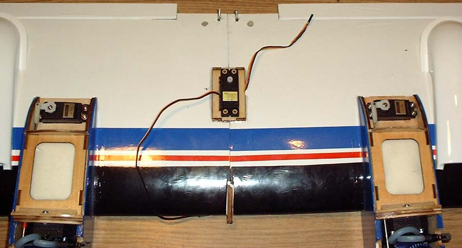 Three servos are installed in the wing, two throttle and one aileron.