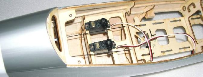 Elevator and rudder servos with push rods assembly.
