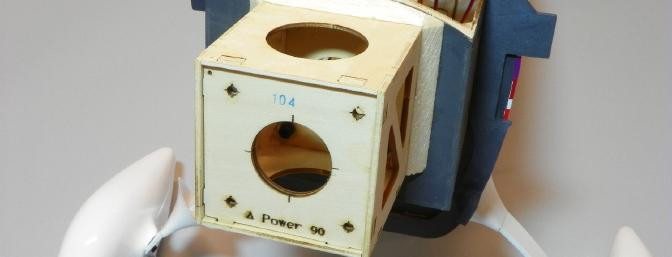 The plywood motor box is attached to the firewall.