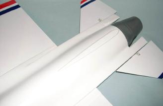 Fin mounting base on top of fuselage.